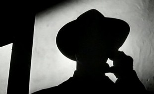 stock-footage-silhouette-of-man-speaking-on-telephone
